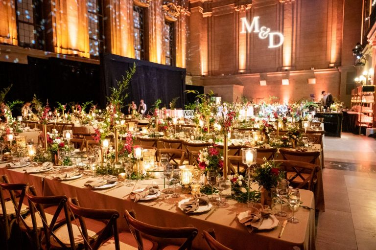 Contemporary wedding decor in gold with wooden details at Le St-James Theater